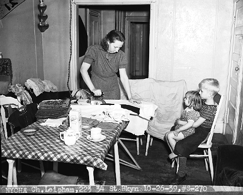 Mrs. Leipham and her children in the kitchen of their apartment at 223 34th Street, Brooklyn, next to Greenwood Cemetery, October 26, 1939.  