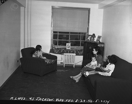 Ms. M. Lopez and her children in their new apartment at 45 Jackson Street, in Vladeck Houses, on the Lower East Side of Manhattan, August 20, 1940. 