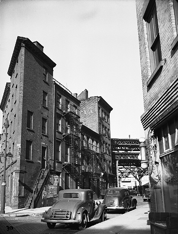 Gone...Roosevelt and North Chambers Streets looking toward the approach to the Manhattan Bridge, January 2, 1946. This is the future site of Smith Houses. ID# 02.003.05903
