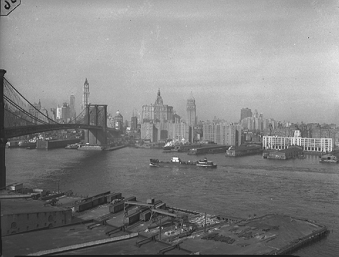 Smith Houses under construction -- the tall grayish buildings to the right of the Brooklyn Bridge, January 19, 1950.  ID# 02.003.11282