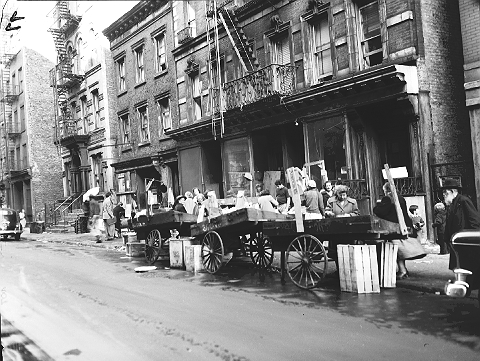 Street market on the Lower East Side, November 19, 1950. These tenements were torn down for the construction of Bernard M. Baruch Houses.  ID# 02.003.14072