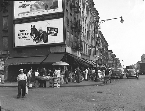 A busy shopping area at East 113th Street and 1st Avenue in East Harlem, Manhattan, September 7, 1951. This neighborhood was razed to build the 1959 Thomas Jefferson Houses, a 17 acre site that houses 3,729 people. 