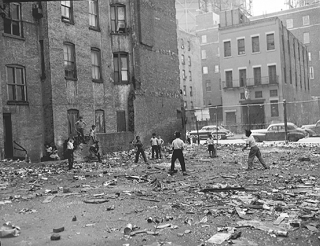Not the best field for stickball -- a rubbish-strewn vacant lot on East 112th Street between 1st and 2nd Avenues in East Harlem, September 7, 1951. This would become part of the 17 acres cleared to build the 1959 Thomas Jefferson Houses.  ID# 02.003.15228