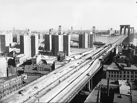 Smith Houses nearing completion, seen from the Manhattan approach to the Brooklyn Bridge, October 17, 1952.  ID# 02.003.17330
