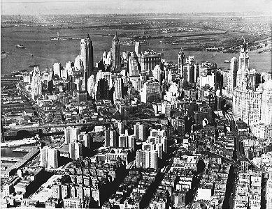 Aerial shot of Lower Manhattan, showcasing the whitish towers of the Gov. Alfred E. Smith Houses in the left foreground, October 10, 1952. Photo was apparently taken for Lone Star Cement Company, presumably a building supplier of the project.  ID# 02.003.17369
