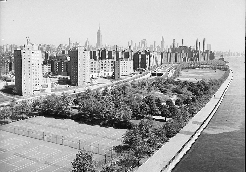 "The ""wall of public housing"" along the East River, from the Williamsburg Bridge to the smokestacks of the Con Edison power plant, May 25, 1954. From left to right, Bernard Baruch Houses, Lillian Wald, and Jacob Riis. ID# 02.003.19860"