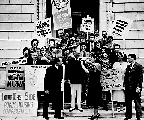 New York Senator Robert F. Wagner (center) poses with a group of Lower East Side supporters of the Wagner-Steagall housing bill of 1937.  ID# 02.003.19895