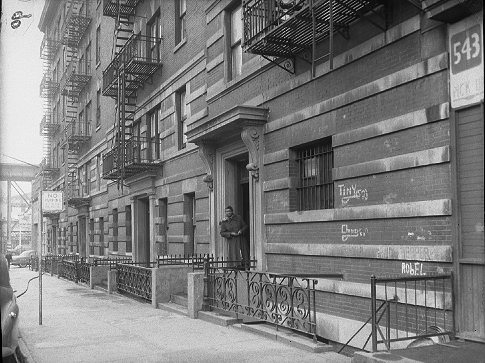 "543-45 West 129th Street in Harlem, March 13, 1956. Note graffiti ""tags"" on wall of the tenement, which was torn down to build the 12-acre Manhattanville Houses.  ID# 02.003.23146"