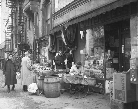 Fresh fruit and vegetable store on the Lower East Side of Manhattan, circa 1956. These buildings were replaced with Samuel Gompers Houses.  