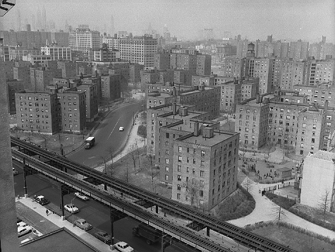 Fort Greene Houses in Fort Greene, Brooklyn, with the Myrtle Avenue El in the foreground, March 13, 1958. The project contains 35 buildings covering 41 acres, and houses up to 13,000 people. It is now called Whitman Houses and Ingersoll Houses.  ID# 02.003.26873