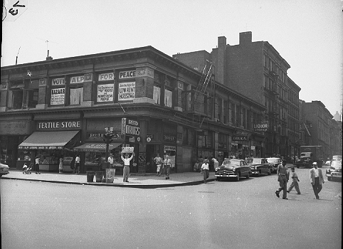 102 to 108 West 104th Street and the corner of Columbus Avenue on the upper West Side of Manhattan, circa 1951. Ironically, the American Labor Party office has window placards calling for low-rent housing which did in fact replace these buildings.  ID# 02.003.41595