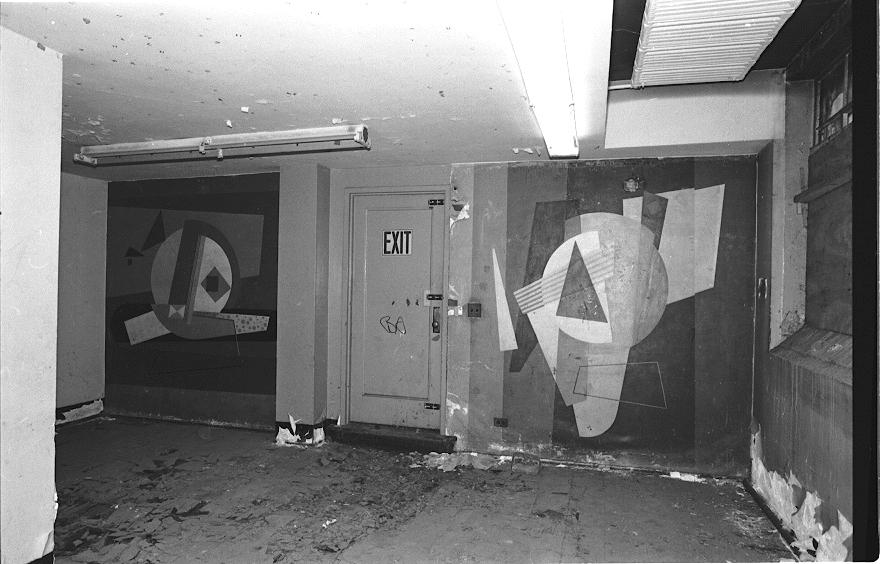 "These murals and three others painted in 1937-38 by four founders of American Abstract Artists, an influential co-operative exhibition group, and installed in the basement community rooms at Williamsburg Houses in Brooklyn, were abandoned to neglect and damage for decades (photo circa 1986). These two Federal Art Project-sponsored panels were executed by Paul Kelpe (1902-85) and were in the best shape of the five panels. Painted by Ilya Bolotowsky (1907-81), Balcomb Greene (1904-90), and Albert Swinden (1901-61), the three other murals had been ignored, painted over, and otherwise vandalized. The art works were ""rediscovered"" and restored by NYCHA in 1988. Loaned to the Brooklyn Museum in 1990, the five murals were appraised at $2.5 million. 