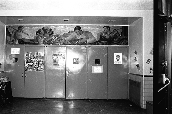 "Red Hook Houses community center in Red Hook, Brooklyn, November 18, 1985. Part of the lobby mural, entitled ""Blueprint for Living,"" painted by Marion Greenwood (1909-1970) in 1940 for the WPA Federal Art Project. This may be the only panel of the triptych that still exists. ID# 02.003.44672M"